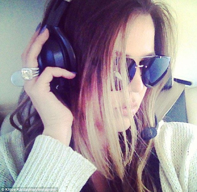 Headgear at the ready: Khloe appeared to be enjoying a helicopter ride on Monday
