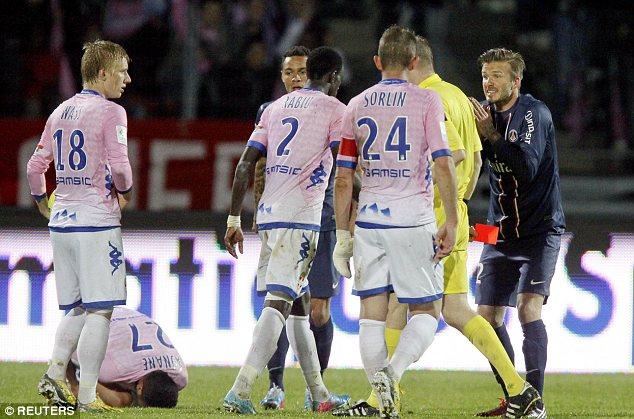Pleading innocence: David Beckham was sent off for a tackle on Youssef Adnane