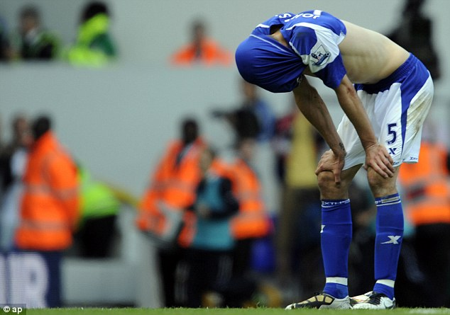 Distraught: Roger Johnson as Birmingham drop out of the Premier League in 2011