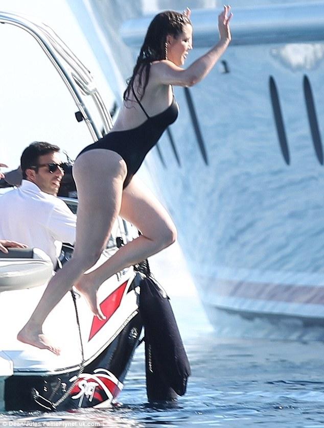 Jump for joy: Khloe Kardashian paraded her slimmed down figure on Saturday in Mykonos, Greece