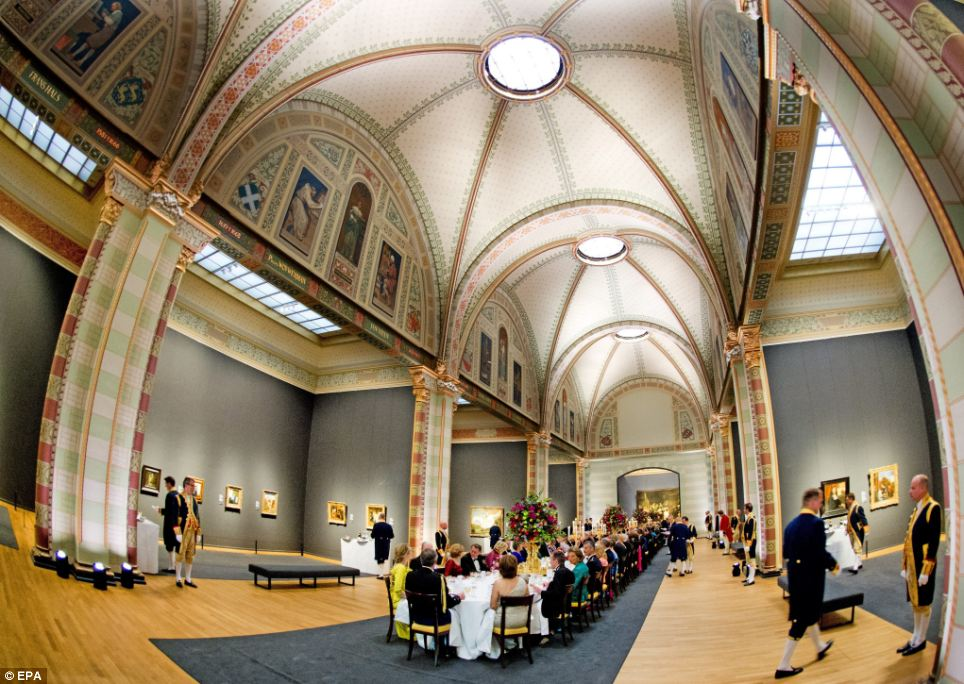Exquisite: The stunning view of the dinner hosted by Queen Beatrix of The Netherlands at the Rijksmuseum in Amsterdam, which recently opened after a ¿375m renovation