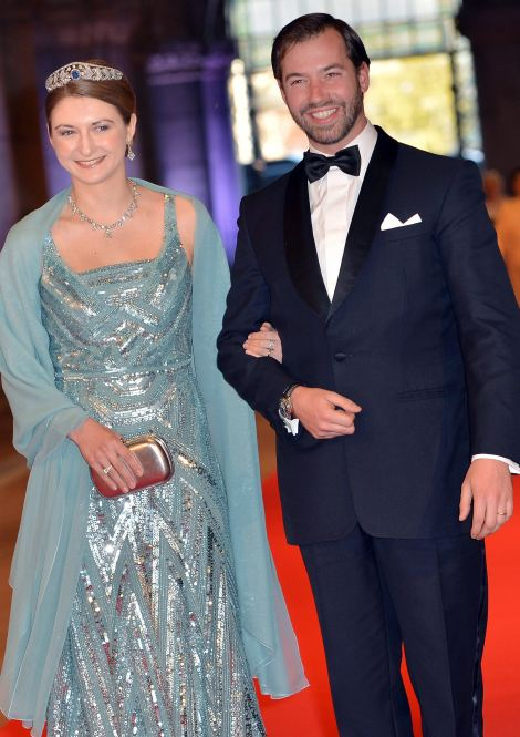 Grand Duchess Stephanie of Luxembourg, left, and Grand Duke Guillaume of Luxembourg arrive for a dinner at the occasion of the abdication of Dutch Queen Beatrix and the investiture of Prince Willem Alexander as King