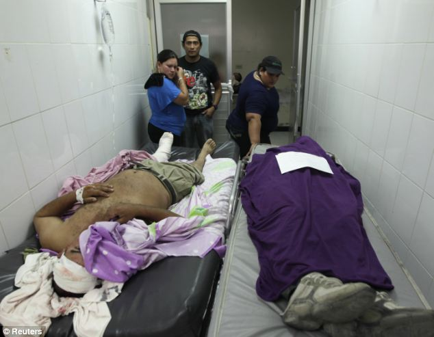 Tragedy: People observe the dead body of a family member