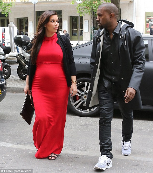 Cheer up, you're in Paris! Kim looked to be having an intense conversation with Kanye
