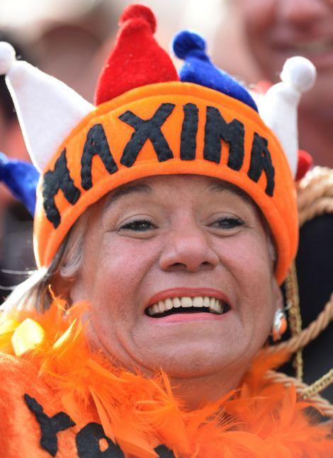 A woman wears a hat reading