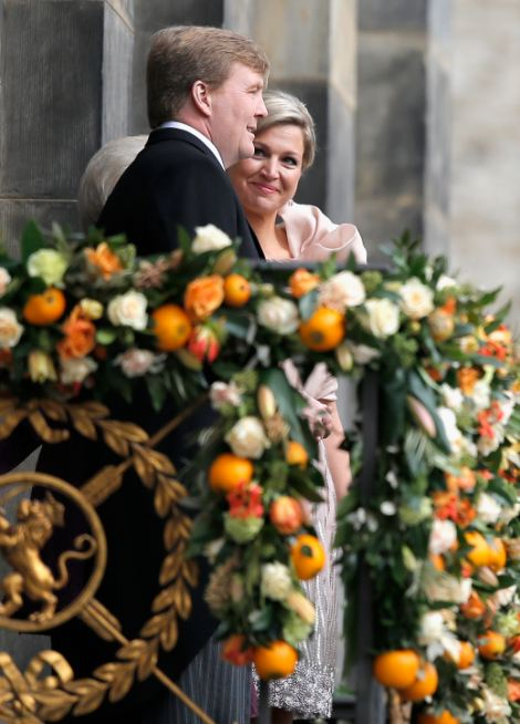 King Willem Alexander and Queen Maxima of the Netherlands appear on the balcony