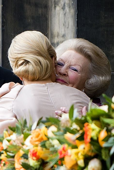 Princess Beatrix (R) of the Netherlands accompanied by her son King Willem-Alexander embraces Queen Maxima