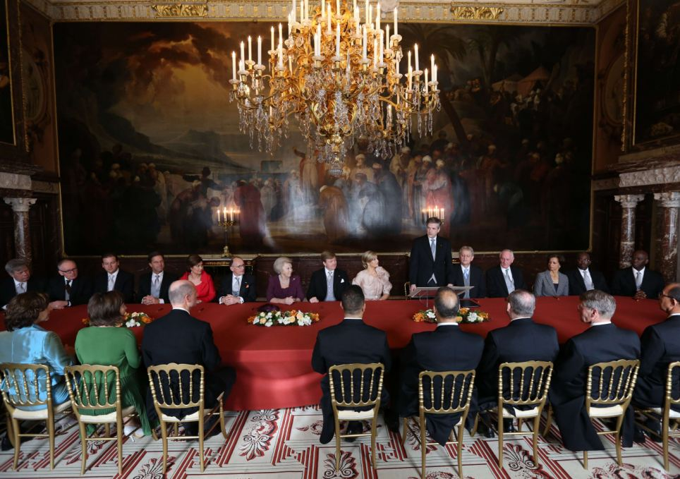 Change: Beatrix signed the abdication document in front of the Dutch cabinet in an ornate room today