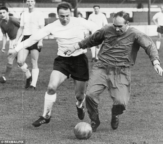 Mixing it up: Alf Ramsey (right) shields the ball from George Cohen in an England training session