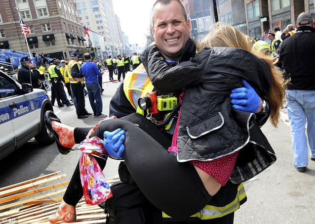 The terror: A Boston firefighter carried an injured girl away from the scene after the Boston Marathon bombings. In all, Tsarnaev is believed to have killed three Americans, including an eight-year-old boy