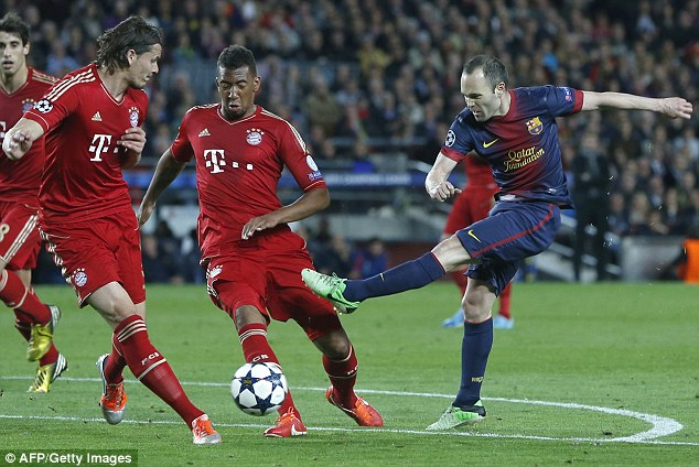 Crowded out: Andres Iniesta (right) attempts to shoot past Daniel van Buyten and Jerome Boateng