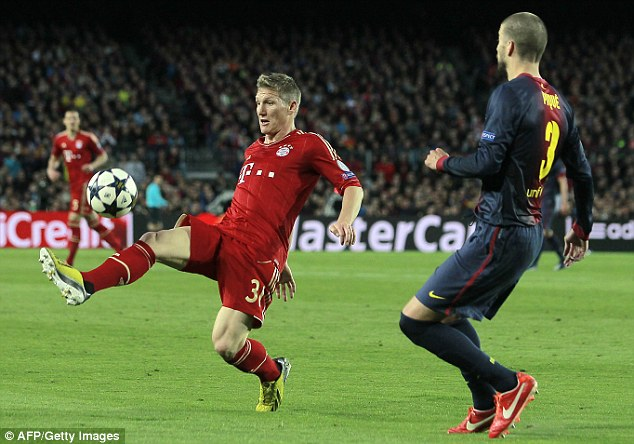 Eye on the ball: Pique closes down Bastian Schweinsteiger