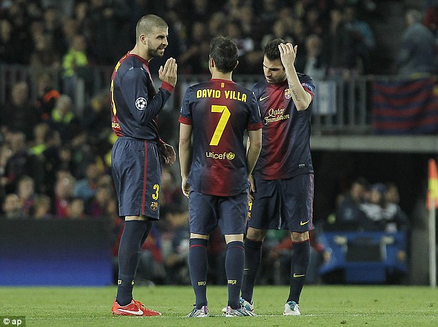 What's gone wrong? Gerard Pique, David Villa and Cesc Fabregas were left scratching their heads