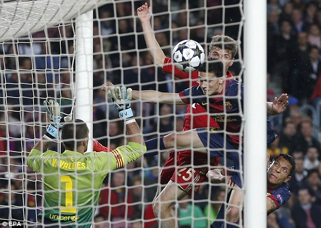 Salt in the wounds: Bayern's Thomas Muller (centre left) headed in a third goal late on