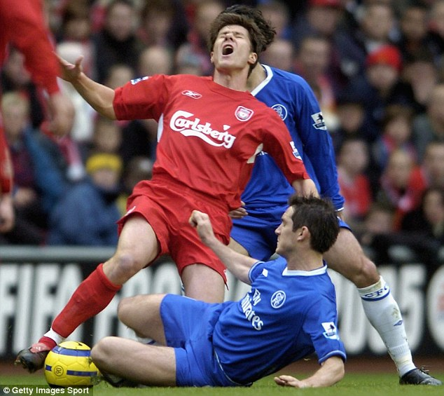 Getting stuck in: Lampard slides in on Alonso in 2005