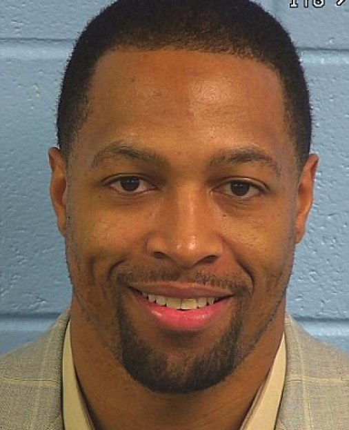 Grin and bear it: Michael Boley pictured smiling in his mugshot from February 8, when he turned himself in as part of a plea agreement