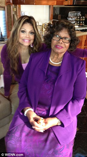 Family tradition: Katherine, seen with daughter La Toya, raised her family in the religion and sees preaching as an important part of the faith