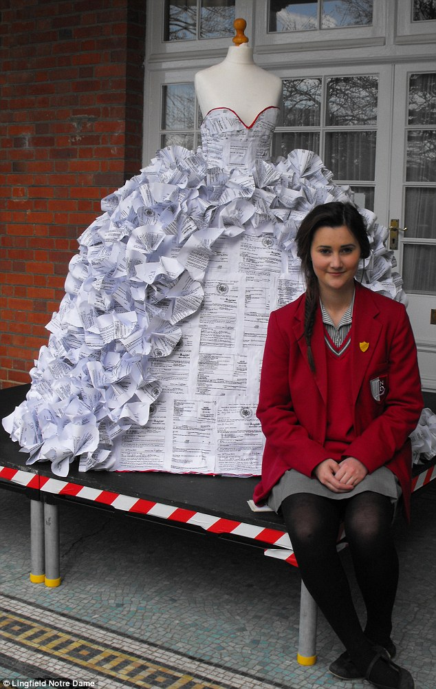 Online hit: Demi Barnes's wedding dress made from more than 1,500 divorce papers has gone viral after she posted a picture of it on Facebook