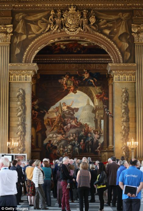 Majestic: Visitors gather around the restoration work which has cost £335,000 to complete and is part of a wider project to restore the entire Painted Hall
