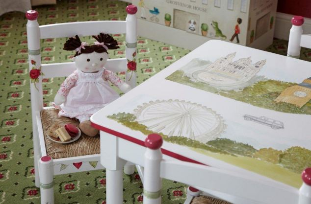 Tiny throne: The toddler-sized chairs and table are just right for young visitors. Scenes of Buckingham Palace and the London Eye adorn the play table