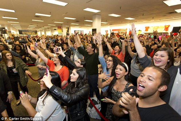 Fan-demonium: Thousands of Kardashian lovers gathered at the store in the hope of meeting their idols