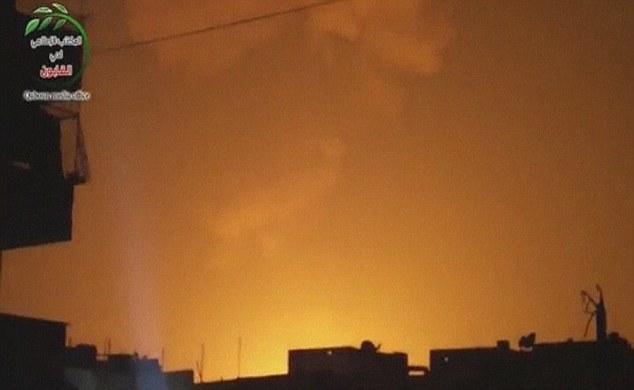 Glowing: The sky is lit up after an explosion at what Syrian state television reported was a military research centre in Damascus early today