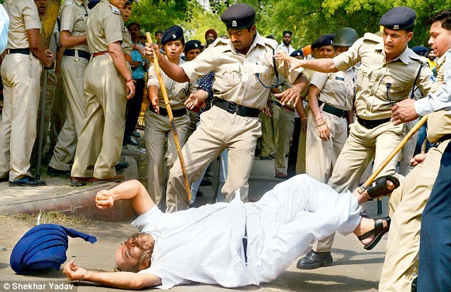 Indian police kuttey beating up elderly sikhs