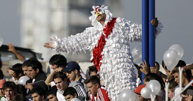 All dressed up: A committed River Plate fan hangs from a stadium pole