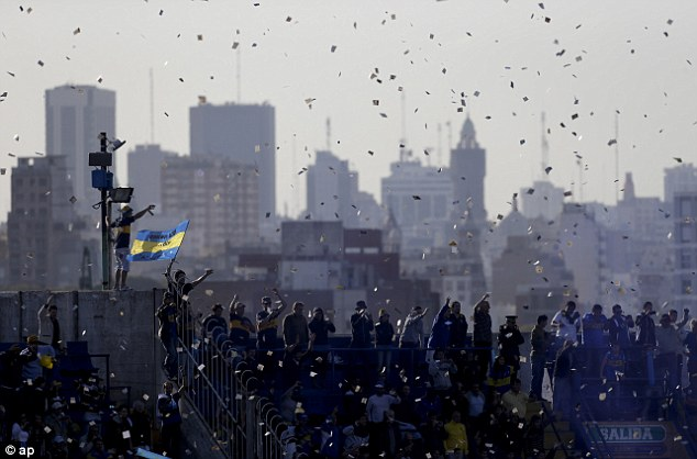 What a backdrop! Boca fans throw ticker tape into the air