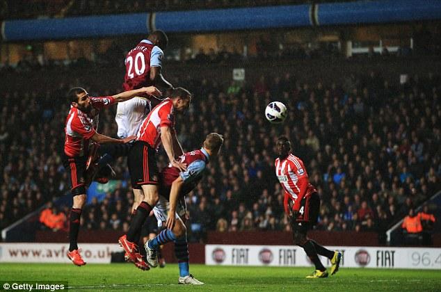 Towering presence: Benteke rises highest to score one of his three goals against Sunderland last week
