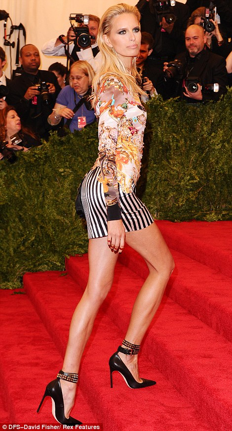 Legs eleven: Karolina Kurkova displayed her super long legs in a printed mini dress paired with black leather stilettos featuring studded straps
