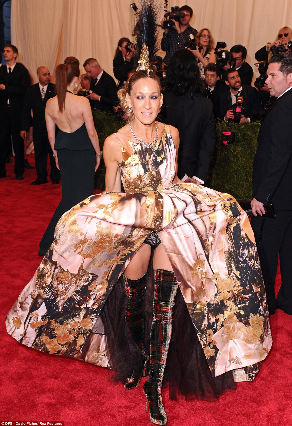 Going all out: Sarah Jessica Parker, in a Giles Deacon dress, Philip Treacy headpiece and Louis Vuitton boots, put all the other guests to shame with her amazing and elaborate outfit