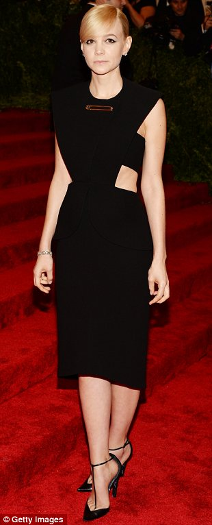 A cut above the rest: (L-R) Miranda Kerr in Michael Kors, Emma Watson in Prabal Gurung and Carey Mulligan in Balenciaga all sported cut-out black dresses
