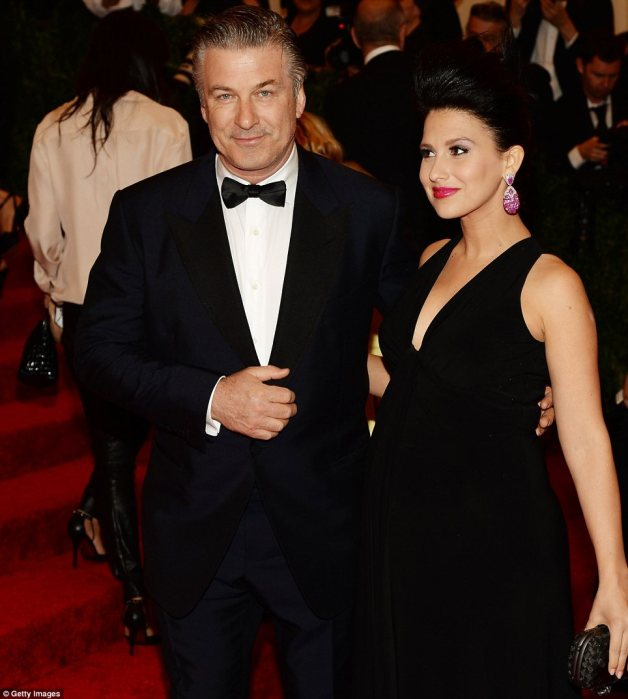 Proud parent-to-be: Alec Baldwin placed an arm tenderly around his pregnant wife Hiliara