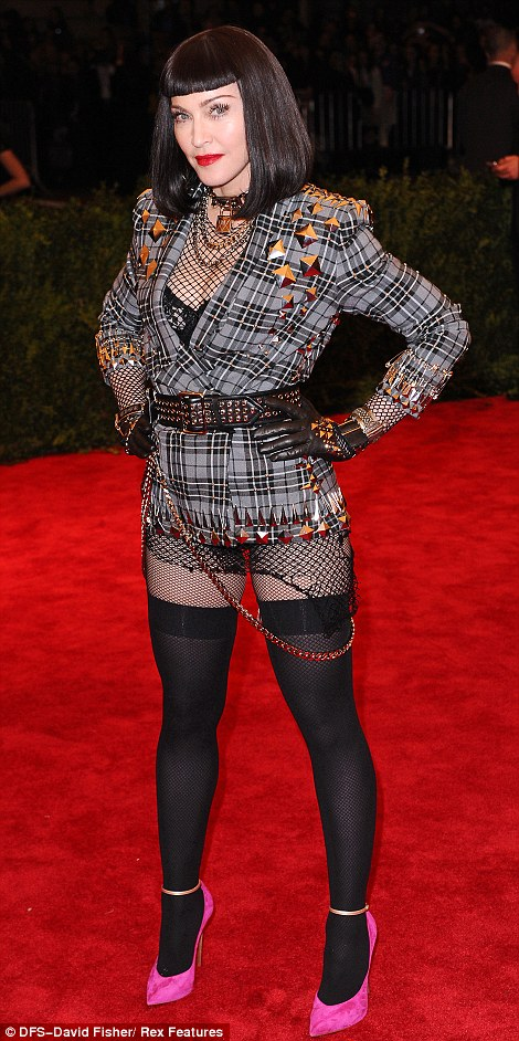 Hilary Devey, is that you? Madonna seemed to be emulating the Bolton entrepreneur with her black wig and Givenchy Haute Couture by Riccardo Tisci tartan jacket and a pair of fishnets which left her derriere on show
