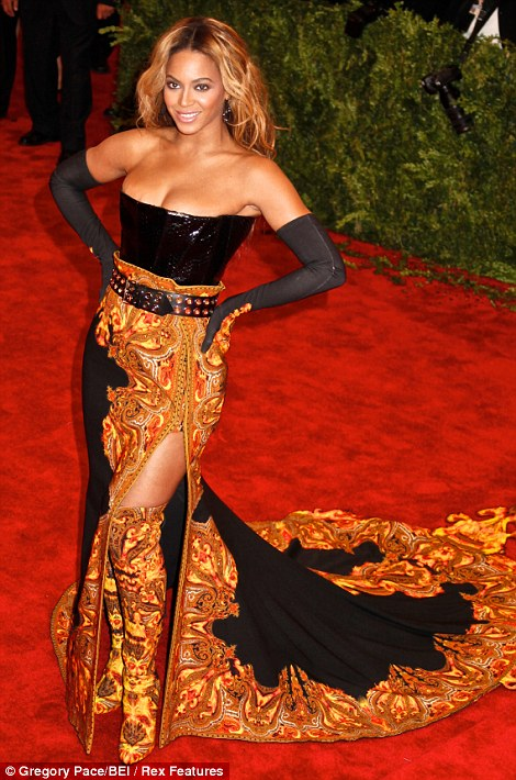Coordinating: Beyonce even had boots made to match her flaming dress (and she topped off the outfit with matching gloves)