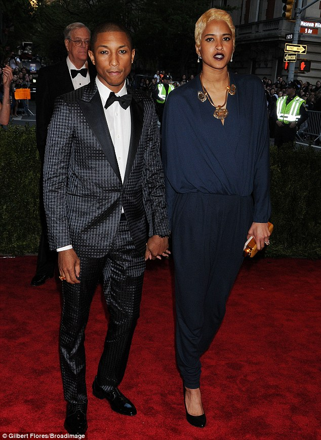 Stylish pair: Earlier in the evening, Pharrell and Helen cut a fashionable two-some as they arrived at the star-studded bash