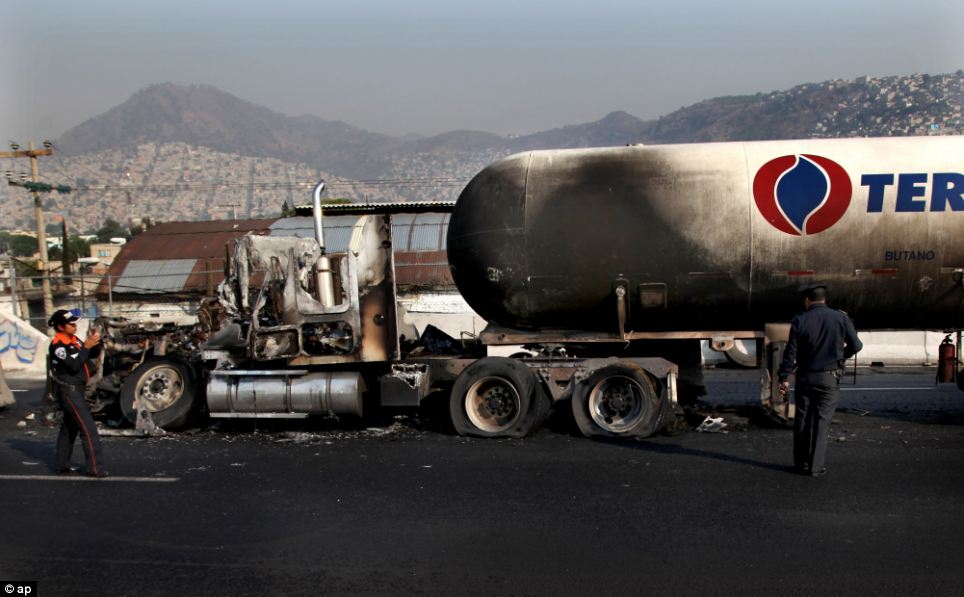 The remains of a gas tanker sits on a highway in the Mexico City suburb of Ecatepec, after it exploded