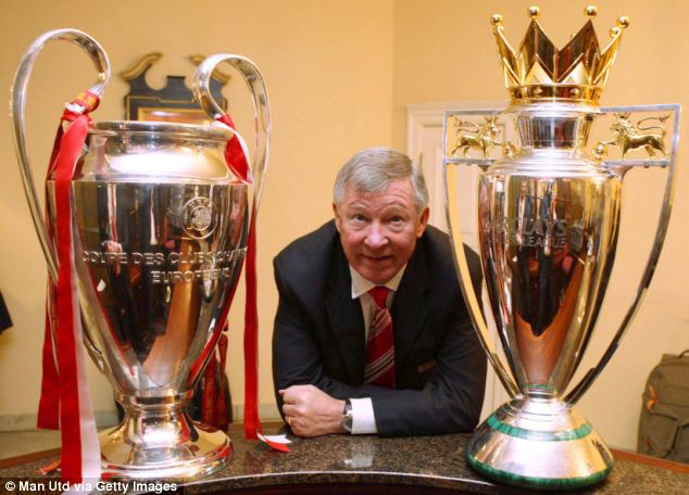 Glory days: Sir Alex pictured with the Champions League and Premier League trophies
