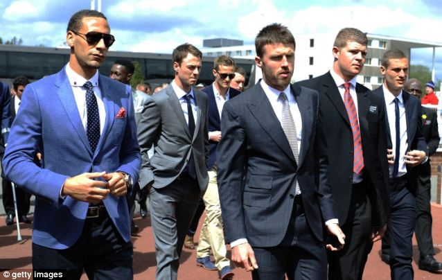 At the races: Manchester United players Rio Ferdinand, Jonny Evans, Michael Carrick and Nemanja Vidic arrive at Chester racecourse today, shortly after boss Sir Alex Ferguson announced his retirement