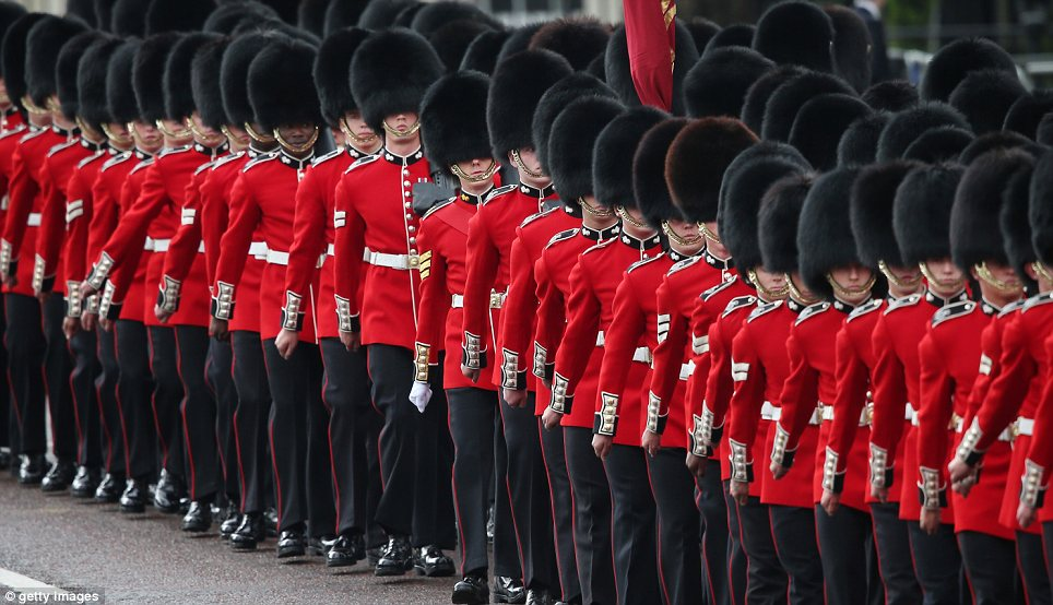 Route: Members of The Guards march on The Mall as the Queen heads to Westminster
