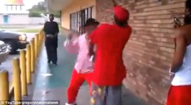 Swinging: Rocky Lockridge knocks out a member of the public who gave him abuse