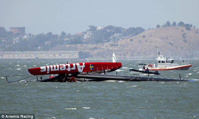 Accident: The capsized Artemis catamaran, a 72-foot America's Cup entry from Sweden, is towed past Treasure Island in San Francisco Bay