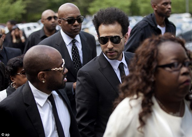 Solace: Producer Jermaine Dupri provided comforting words to Chris Smith as they arrived to the service