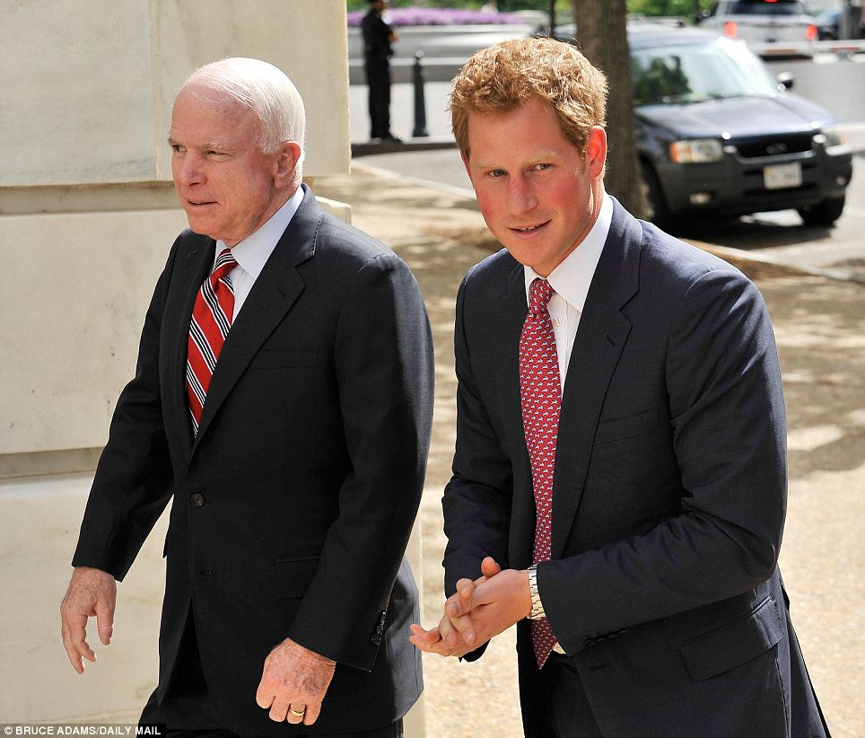 Here comes trouble! Prince Harry is greeted by senator John McCain at Capitol Hill, Washington DC on Thursday afternoon at the start of his nine-day tour of the United States