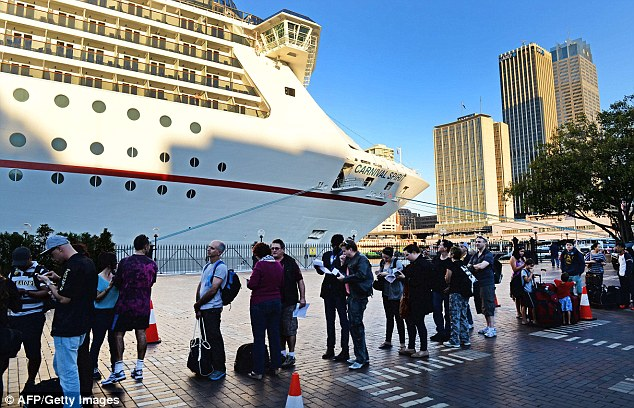 Passengers for the next Carnival Spirit cruise lined up ready to board it yesterday as the search of the ship continued