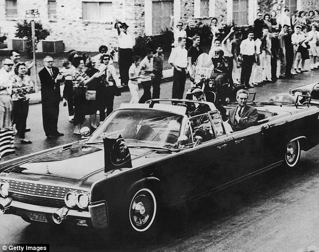 Just moments before: The presidential motorcade through Dallas a few moments before John F Kennedy, 35th President of the United States, was shot