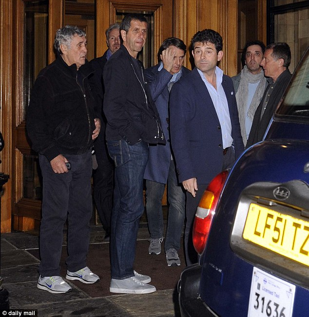 Entourage: Mancini was surrounded as he came out of the hotel