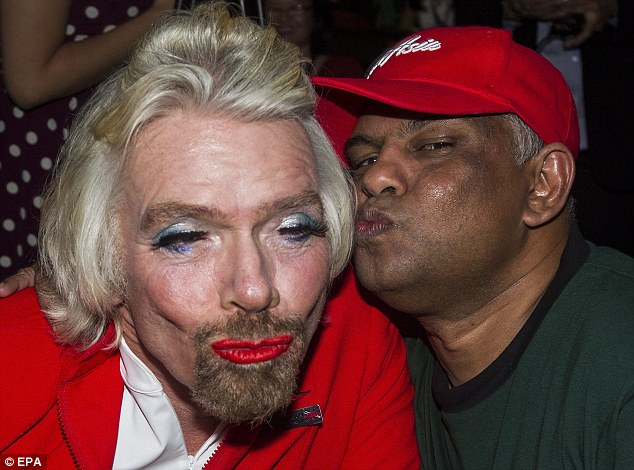 Pucker up! Richard Branson wore a full face of make-up for a flight to Malaysia after losing a bet to AirAsia chief Tony Fernandez