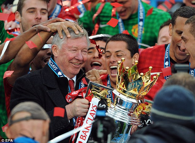 One last time: Sir Alex Ferguson lifted his 13th Premier League trophy after watching his side beat Swansea at Old Trafford